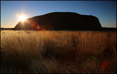 Uluru Sunrise (kc_y0 (Away for a while)) Tags: light red sun 3 nature grass rock sunrise canon eos mark iii australia center flare 5d outback uluru northern ayers territory