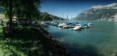 Mols (Elliott Bignell) Tags: switzerland suisse svizzera schweiz mols walenstadt walensee churfirsten churfrsten lake see bergsee gebirgssee walen boats harbour boote hafen mountains mountain berge berg alpen alps alpine alp