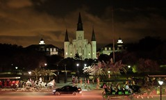 Jackson Square Nighttime (Neal3K) Tags: neworleans louisiana night jacksonsquare carriages tourists church andrewjacksonstatue stlouiscathedral horses irvisible infraredandvisiblelight kolarivisionmodifiedcamera palms clouds light streetlights pedestrians flagpole