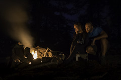 Camp Fire () Tags: camping fire couple night atmospheric light darkness woods forest mountain outdoors sky