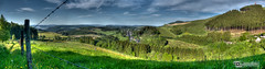 Blick ins Sauerland (Dominik Hartmann) Tags: blue summer sky panorama mountain green berg field clouds forest canon fence germany landscape deutschland dorf village sommer feld wiese himmel wolken nrw grn blau zaun landschaft wald hdr stacheldraht sauerland 550d bestwig ramsbeck andreasberg