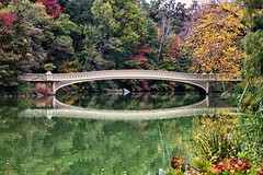 Autumn at Bow Bridge (CVerwaal) Tags: nyc autumn newyork canon reflections centralpark autumncolors bowbridge thelake canons100 autumninnewyork
