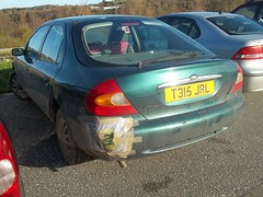 Reuseable bags (occama) Tags: ford car shopping bag duct cornwall 1999 plastic tape bumper repair damaged reg registration cornish mondeo gaffa