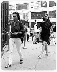 meatmarket lunch hour (omoo) Tags: newyorkcity bw woman legs streetscene lunchhour beautifulwoman streetscenes bwphotograph shortblackdress meatmarketdistrict dscn4425 lunchhourmeatmarket meatmarketlunchhour westvillageatchelseaedge wet14thandninthavenue