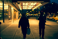 from the glow (keunerr) Tags: city people chicago night contrast lights luces noche couple gente pareja hilton pedestrian fromtheglow