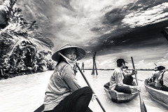 Our Vietnamese boatwoman  after our exciting ride. (julesnene) Tags: travel bw water boats boat asia southeastasia monotone vietnam adventure waters mekongdelta mekong touristattraction hardworker mekongriver strongwoman boatwoman nónlá canoneos7d julesnene juliasumangil