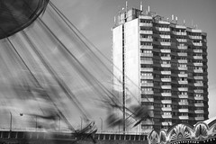 Just an urban merry-go-round, Margate (Sean Hartwell Photography) Tags: merrygoround amusements funfair fairground rides movement monochrome modernarchitecture arlingtonhouse margate kent england british seaside resort brutalism concrete tower block housing urban decay