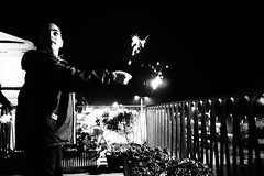 Non ti distrarre (Gabrielradio) Tags: rosso bw newyearseve year fireworks bianco e nero black shite monocromo monochrome childhood girl happiness party expectations terrace balcony family together