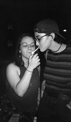 Sophia and Peri smoking outside the Vundabar show (beccachairin) Tags: ilford hp5 film bw blackandwhite 35mm analogue pointandshoot leica portrait portraits boston