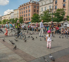 square (stevefge) Tags: krakow poland oldtown squares people candid girls pidgeons bicycles bikes summer reflectyourworld