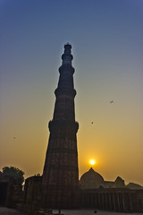 Sunrise at Victory Tower (AnkurDauneria) Tags: world travel india art heritage tourism monument architecture century canon temple eos site war worship asia muslim mosque unesco mausoleum monarch 1855mm pillars hindu 12th efs emperor newdelhi qutubminar watchtower quran asi towerofvictory subcontinent redstone mughal rajput redsandstone archaeologicalsurveyofindia ghori iltutmish incredibleindia victorytower indraprastha apsc qutubuddinaibak 27hindutemples