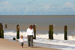 Great Yarmouth Sea Front (OmanDry) Tags: sea woman canon walking eos 350d child barefoot talking greatyarmouth windfarm august2006 omandry