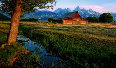First Light at Mormon Row (Jeff Clow) Tags: ranch old morning travel mountains building tree tourism nature water barn rural landscape outside outdoors wooden ancient stream quiet getaway farm peaceful serene grandtetonnationalpark jacksonholewyoming moultonbarn thomasamoultonbarn tpslandscape