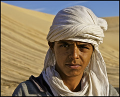 berber boy of the sahara .... (ana_lee_smith) Tags: africa travel boy portrait people tourism sahara lens photography desert native tunisia south traditional north photojournalism documentary social berber kit 1855mm language turban tribe region indigenous nomadic chech f3556 tamazight analeesmith sonyslta33