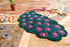 Diwali Rangoli 3 (Muslim Kapasi) Tags: india art beautiful festival rock circle flickr colours floor sale drawing circles salt culture peacock celebration round bombay getty colourful draw tradition diwali mumbai sell hindu celebrate kolam rangoli gulal