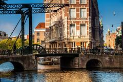 Amsterdam - Dutch Structures (Nomadic Vision Photography) Tags: amsterdamcanal jonreid amsterdamarchitecture dutcharchitecture doelenhotel tinareid nomadicvisioncom thestaalstraatbridge innercanals thekloveniersburgwalcanal