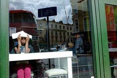 Reflex (Michael Goldrei (microsketch)) Tags: mcdonalds sunny shield window street reflection 2016 pancras photos girl photographer london st photography fuji sat cross photo sitting kings lady woman sit reflections green kx saint king fujifilm reflect guard sun too x100t visor t bright pink film august 16 aug xseries 100 kings x