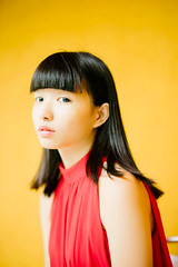 Hanna (I C E I N N) Tags: e fe sony outdoor photoshoot asian girl moody melancholy gaze people portrait classic pose red top blackhair yellow wall sonya7ii ilce7m2 zhongyi mitakon speedmaster 50mm f095 dof creamy blurry hanna