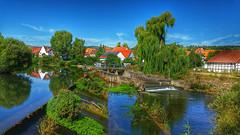 Rural idyll (RainerSchuetz) Tags: river weir village rural dreamscape