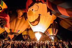 Happy Bright Boy (djking) Tags: alberta canada heritageinninternationalballoonfestival highriver boy face hotairballoons night