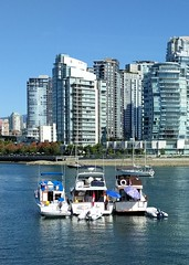 Boat community (Ruth and Dave) Tags: falsecreek vancouver inlet sea ocean boats moored three together group parasol umbrella friendly city skyscrapers