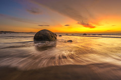 Moeraki Solo (Arief Rasa) Tags: beach boulder boulders cloud coast coastline cracked dusk erosion famous formation geological geology koekohe landmark landscape moeraki morning nature new ocean otago phenomenon pool rock rocky round sand sea seascape shallow shore sky sphere spherical stone sun sunrise sunset surf tidal tide travel twilight waves weathered wet zealand