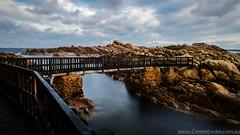 Bridging the gap (CreateEvoke) Tags: ocean bridge sea water clouds landscape coast nikon rocks gap coastal wa coastline void footpath yallingup rickety southwestwa canalrocks d7000