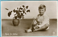 1934 boy with toy sailboat (oldsailro) Tags: park old boy sea summer people sun lake playing beach water pool girl sunshine youth sailboat race vintage children fun toy boat miniature wooden pond model waves sailing ship child with time yacht antique group boom regatta mast hull spectators watercraft 1934 adolescence keel fashioned