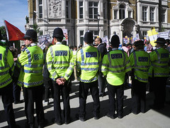 Standing Behind the Row of Policemen (Kombizz) Tags: street people london poster israel palestine helmet banner photojournalism flags demonstration zionism mayfair holyland placard helmets policemen americanembassy palestinian occupation grosvenorsquare 6367 highvisibilityvest ihrc highvisvest ayatollahruhollahkhomeini imamkhomeini qudsday policeperson islamichumanrightscommission kombizz standingbehind palestinanflag hivisvests alqudsdaydemonstration qudsday2012 zionistoccupation rowofpolicemen w1a2lq standingbehindtherowofpolicemen