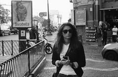(Ray Ban Girl) (Robbie McIntosh) Tags: leica portrait blackandwhite bw film girl monochrome face sunglasses analog 35mm kodak candid trix streetphotography hc110 rangefinder stranger bn summicron negative 400 analogue m6 biancoenero rayban argentique wayfarers leicam6 dyi selfdeveloped pellicola kodaktrix400 analogico leicam6ttl leicam filmisnotdead kodakhc110 hc110dilb autaut leicasummicron50mmf20iv summicron50mmf20iv leicasummicron50mmf2iv pushed800iso