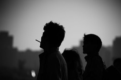 they arrive seeking thrills (~mimo~) Tags: china street city blackandwhite woman men silhouette photography asia shanghai walk cigarette candid horizon young adventure odc mimokhair
