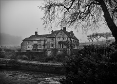 The Mill House at Stedham (Robots are Stupid) Tags: uk england blackandwhite bw house mist mill monochrome parish misty fog architecture rural river grey sussex mono nationalpark lowlight village gloomy rainyday westsussex britain foggy bleak gloom mansion riverbank manor southdowns weir midhurst countryhouse millhouse poorlight milllane riverrother englishvillage stedham x100 ruralengland iping countryestate ruralsussex woolbeding sussexvillage sussexcountryside southdownsnationalpark countrypile fujifilmx100 fujix100 daviddalley davidjdalley stedhamwithiping milllanestedham stedhammill millhousestedham lipchisway newlipchisway