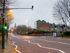 Camden Road (MyParadiseLost) Tags: road green cars trafficlight crossing dusk camdenroad cityislingtoncollege
