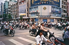 Take care when crossing (Alex L'aventurier,) Tags: life street city people urban danger corner dangerous coin vietnamese chaos crossing traffic crowd bikes scooter vietnam busy mopeds intersection foule jam circulation rue saigon hochiminhcity metropolitan personnes ville motos trafic urbain masse vhicules occup