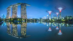 Ultrastructures (Scintt) Tags: city blue sky urban panorama black colour reflection water gardens by skyline bulb architecture modern night clouds marina buildings lights hotel bay hall singapore long exposure cityscape slow place surreal scene images casino card shutter getty sands resorts mode technique stitched raffles integrated scintillation supertrees scintt gettysingapore