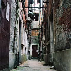 The Alley in ShangHai ( ken ) Tags: china street door building 120 6x6 film bike bicycle rollei rolleiflex alley shanghai kodak   planar   portra160 28e