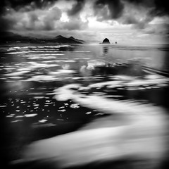 Haystack Rock, Cannon Beach (TroyMasonPhotography) Tags: ocean longexposure blackandwhite bw blur clouds oregon cloudy wave windy pacificocean oregoncoast cannonbeach haystackrock billsbrewhouse troymasonphotographycom troymasonphotography thereismorethanonewaytopassthetime