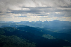 Adirondack High Peaks (Plotz Photography) Tags: trees summer usa mountain ny newyork mountains green clouds america forest landscape open view cloudy country scenic peak overcast upstate adirondacks upstateny summit upstatenewyork wilderness peaks wilmington paysage adirondack whiteface vast adirondackmountains whitefacemountain