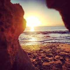 I spy with my little eye (mitchell_hoare) Tags: ocean sunset sunlight beach yellow sand rocks colours footprints wave spy splash