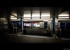 The Concourse (Justin Wolfe) Tags: city railroad blue light urban orange cinema cold reflection film philadelphia public station stairs contrast train canon dark movie underground subway concrete hall downtown alone market centercity cityhall widescreen bare empty sub under columns neglected sigma railway eerie dirty minimal hallway pa forgotten transportation vacant isolation philly septa passage cinematic 169 concourse 215 urbex justinwolfe jwolfe