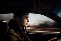 Just Drive (Katherine Lind Photography) Tags: woman brown blur color window girl beautiful face car scarf hair lights drive eyes pretty noir driving sweet dusk gorgeous headlights lips jacket cheekbones breathtaking tailights illcomedriving fastaswheelscanturn