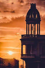 Palacio Ferrer (Simone Della Fornace) Tags: cuba cuban travel traveldestination tourism landmark sunset stairs spiral staircase building architecture historic sun sky clouds summer old palace sony a7rii silhouette orange cienfuegos