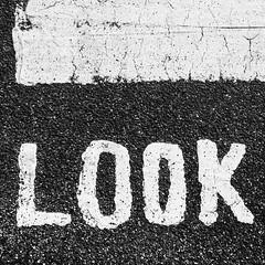 Look! (Peter.Bartlett) Tags: peterbartlett lunaphoto urbanarte urban text monochrome blackandwhite noiretblanc iphone5s cellphone mobilephone tarmac sign square look texture vsco