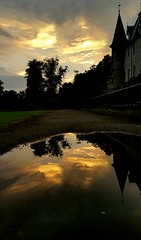 Sunset at Callendar House (DJMGlasgow) Tags: falkirk scotland callenderhouse sunset reflection puddle