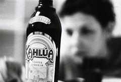 Hélène et le Kahlùa (Sarah Devaux) Tags: visage hélène kahluà alcool soirée bouteille femme silhouette noiretblanc bw argentique silver noise bruit intérieur bordeaux appartement brune liqueurdecafé alcohol girl