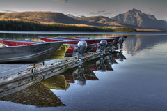 Docked (dbushue) Tags: lake mountains nature reflections landscape boat nikon montana glaciernationalpark 2012 gnp apgar coth lakemcdonald supershot tonemapping absolutelystunningscapes d7000 damniwishidtakenthat coth5 sunrays5