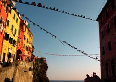 To sit in the shade on a fine afternoon in Riomaggiore (Bn) Tags: world ocean park flowers blue houses sunset sea summer vacation sky orange sun sunlight moon holiday flower tower heritage classic water colors beautiful weather night buildings walking boats coast boat high fishing topf50 warm mediterranean italia sailing ship torre gulf view hiking path five liguria shoreline hike case cliffs lovers quay historic unesco via anchovies national wharf terre sail botanic mountainside quaint viewpoint picturesque coloured cinque adriatic riomaggiore italianriviera torri dellamore 50faves guardiolas