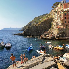 Swimming along the Mediterranean coastline in Riomaggiore (Bn) Tags: family blue sea summer vacation italy baby holiday hot beach water colors sunshine kids swimming children fun coast la seaside jump italian topf50 rocks mediterranean italia day mare afternoon locals play liguria families joy group dive relaxing traditions diving down tourist tourists line resort busy delight parasol grandparents towels cinqueterre bathing activity lying popular quaint monterosso sunbathing pleasure adriatic sunbather riomaggiore crowded youngsters cooling jammed sunbeds overrun 50faves