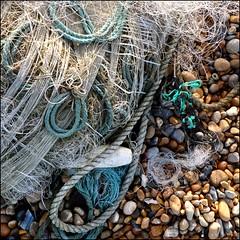 Shoreline (HagleyParkJon) Tags: beach square pebbles rope