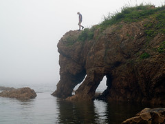 young man on the foggy elephant rock (Maxim Tupikov) Tags: ocean travel trees sea summer brown white mist mountain man tourism nature water rock fog rural landscape outdoors island freedom coast countryside rocks solitude paradise alone moody seascapes natural stones rustic shoreline young scenic conservation environmental wave hidden shore serenity pure desolate preserve tranquil soar preservation protected ecotourism